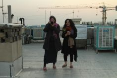 Tahmineh Monzavi and Marjan Vahdat on the rooftops in Tehran, Iran
