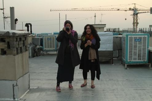 Tahmineh Monzavi and Marjan Vahdat on the rooftops in Tehran, Iran