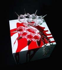 BROKEN PROMISES 2012 Size: Life-size knuckledusters Medium: Lost-wax cast clear glass, metal, lacquer & wood