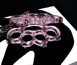 Love & Hate 2012 Size: Life-size knuckledusters Medium: Lost-wax cast pink glass, rhinestone crystals, metal, lacquer & wood